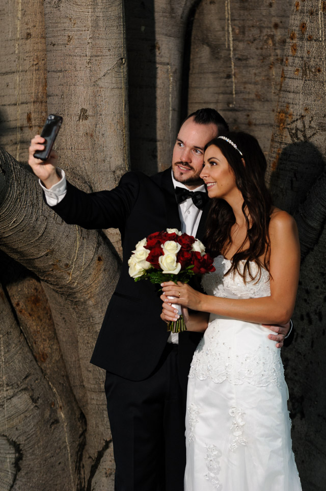 bride-and-groom-selfie-at-their-queens-gardens-wedding